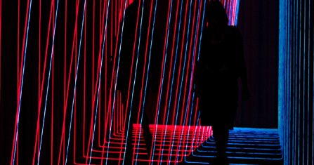 Silhouette of woman standing on red and blue light
